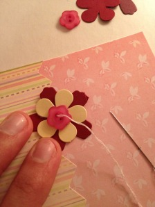 Sewing flowers on card